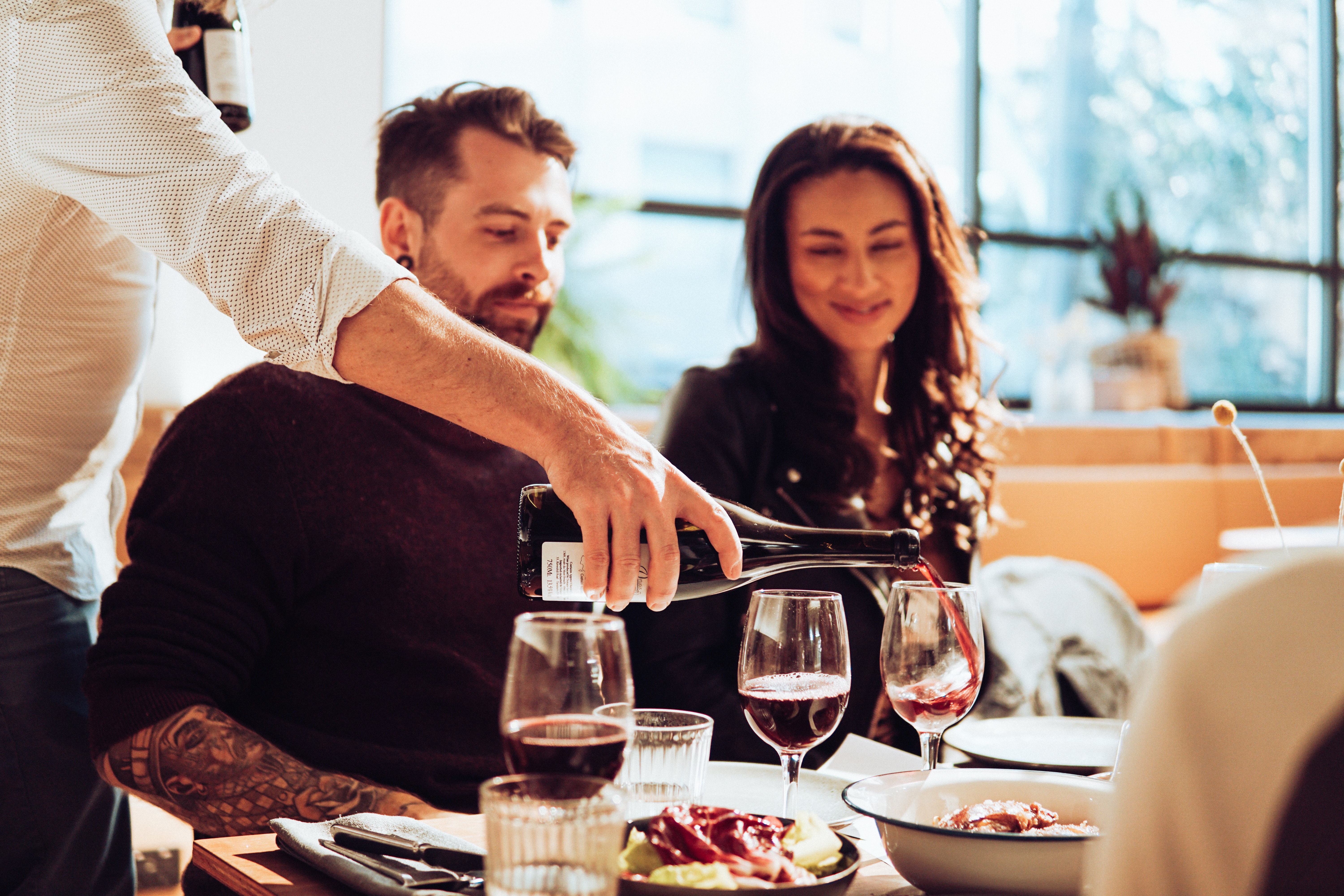 Couple dining with red wine | IFIS Publishing
